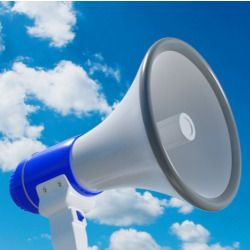 megaphone device against a partly cloudy blue sky