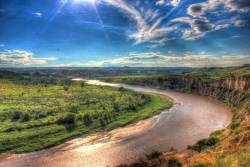 The curving little Missouri River under blue skies at Theodore Roosevelt National Park, North Dakota