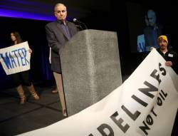 Gov. Dayton rallies support for clean water at summit after facing a protest