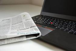 Newspaper and laptop computer
