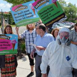 protesters holding signs at a Ben and Jerrys protest march