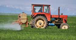Tractor spraying pesticides.