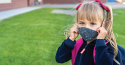 Child with mask.