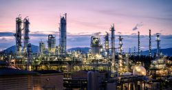 Manufacturing of petroleum industrial plant on sky twilight background, Oil and gas refinery or Petrochemical industry plant with distillation tower