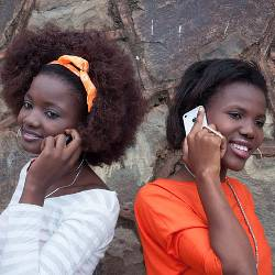 Two girls talking on cell phones