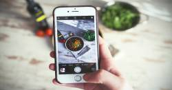 photo of a bowl of food being taken with a cell phone