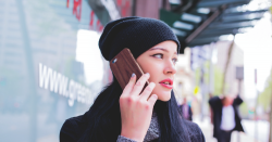 Woman talking on a cell phone.