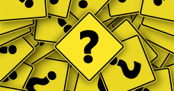 question marks on yellow road signs