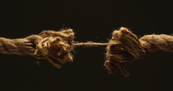 A rope that is breaking.