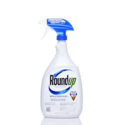 blue and white spray bottle of Monsantos herbicide Roundup