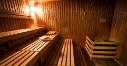electric sauna with wooden benches and a towel