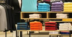 folded shirts on a clothing store display