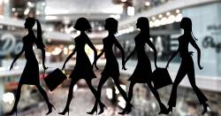 Silhouette of women superimposed on top of an image of a shopping mall