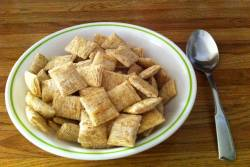A bowl of shredded wheat cereal