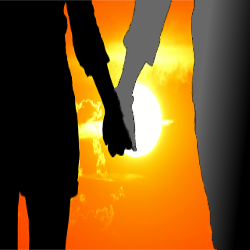 silhouette of two people holding hands at sunset