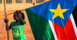 Young girl placing the South Sudan