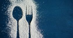 Spoon and fork outlined in white sweetener on a blue background