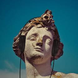 Statue of a person's head with headphones