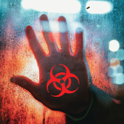 hand against glass with the biohazard symbol