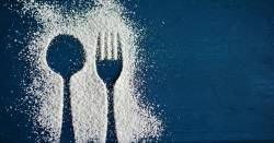 outline of a spoon and fork in powdered icing sugar