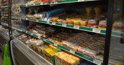 supermarket shelving in the produce section featuring packaged food
