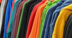 Colorful cotton sweatshirts on a shopping rack