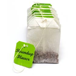 teabag with green tag that says Roundup Flavor