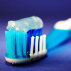 blue toothpaste gel on a blue toothbrush with large depth of field
