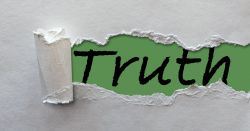 torn paper ripping to reveal the word TRUTH