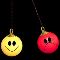 happy faces and unhappy face emojis on Christmas ornaments