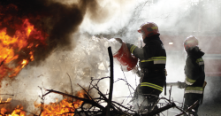 Fire-fighters fighting a fire.