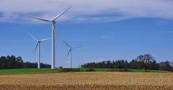 wind turbines producing renewable energy on a farm field