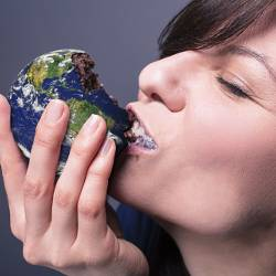 woman eating a cake in the shape of the Earth