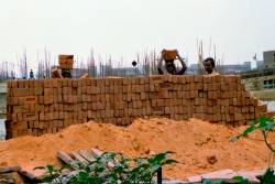Many Bangladeshi migrants and those from coastal Indian towns take up menial jobs in the construction industry and live in slums.