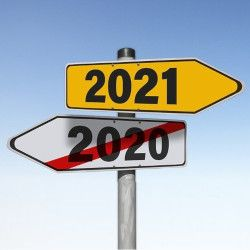 road signs showing 2020 is over and 2021 is next