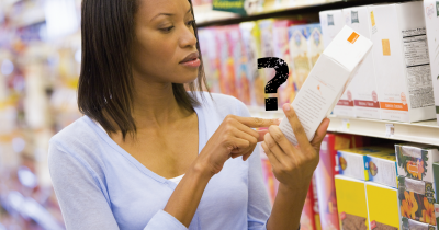 Woman checking label at grocery store.