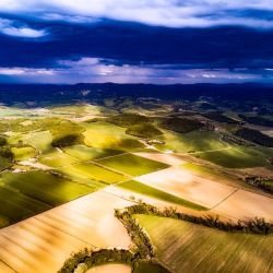 aerial view of a patchwork of farm crop fields