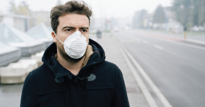 Man with mask for air pollution.