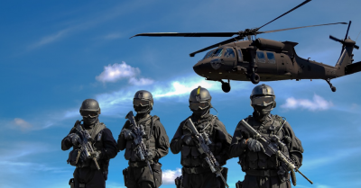 4 army guys with a helicopter flying above
