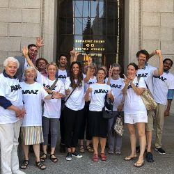 Avaaz members outside courthouse steps