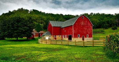 red barn on a farm field in a rural Wisconsin countryside