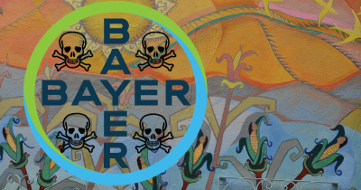 Bayer logo over a mural with skull and cross-bones.