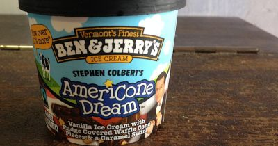 pint of Ben and Jerrys ice cream in AMERICONE DREAM flavor sitting on a wooden table