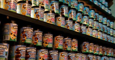 shelves in a grocery store of Ben and Jerrys ice cream pints