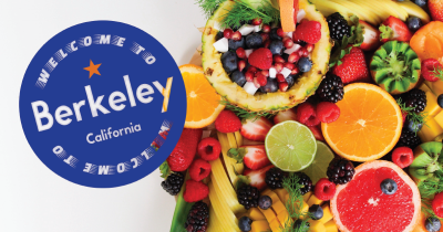 Words that say 'Welcome to Berkeley California' and a background of fruit.