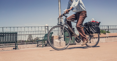 man commuting to work on bicycle in an urban environment