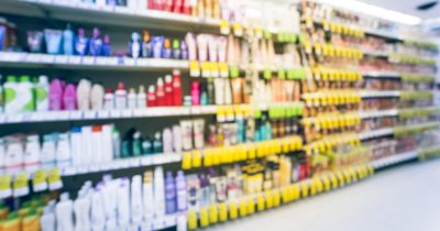 blurry image of a personal care product aisle in a store