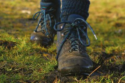 Pair of feet in boots walking along the ground