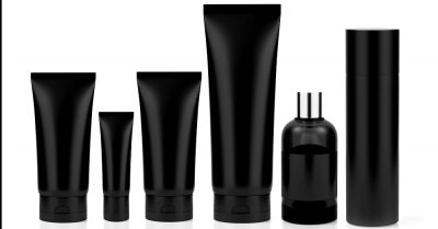 row of black personal care tubes and bottles