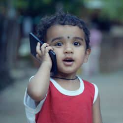 Young child making a phone call on a cell phone